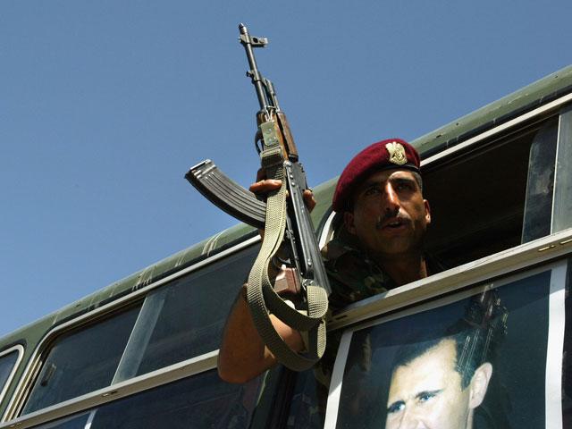 """""""Гвардия Асада"""" штурмует Хомс, ООН требует прекратить бойню"""