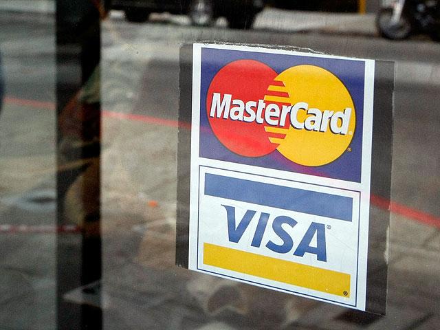 VISA намерена ввести дополнительные комиссионные за операции через Paypal