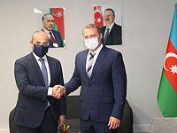 Слева направо: министр экономики Азербайджана Микаил Джаббаров и министр туризма Израиля Константин (Йоэль) Развозов