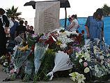 """Около памятника жертвам теракта в """"Дольфи"""" в годовщину трагедии"""