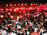 "Сотрудники службы скорой помощи ""Маген Давид Адом"" в Бен-Гурионе. 23 мая 2011 года"