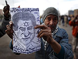 Участник акции протеста в Каире
