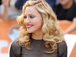 Мадонна осенью 2011 года