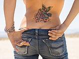 Законопроект: татуировщики обязаны предупреждать девушек об опасности тату на пояснице