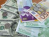 Итоги валютных торгов: курсы доллара и евро выросли