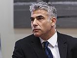 Лапид улетел в Париж накануне голосования по увеличению ставки НДС