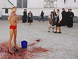 Акция FEMEN на территории Киево-Печерской Лавры. 11 сентября 2014 года