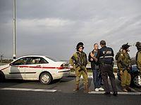 На месте теракта в районе перекрестка Хусан. 12.12.2014