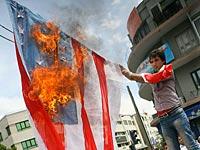 Сжигание американского флага на демонстрации перед Тегеранским университетом, 2009 год